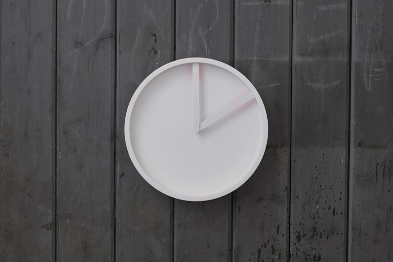 The 'Glow' clock for electronic accessories giant Lexon, has hands with a contrast colour on the underside that bounce a subtle glow offthe clock's face.