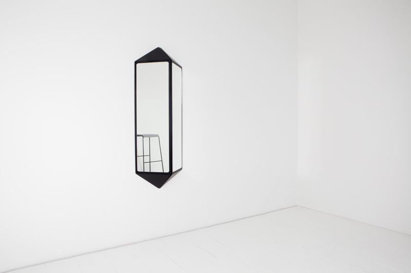 The double mirror version of David Moreland's 'Shadow mirror' inverts the form to project from the wall. Photo: Eve Mackay
