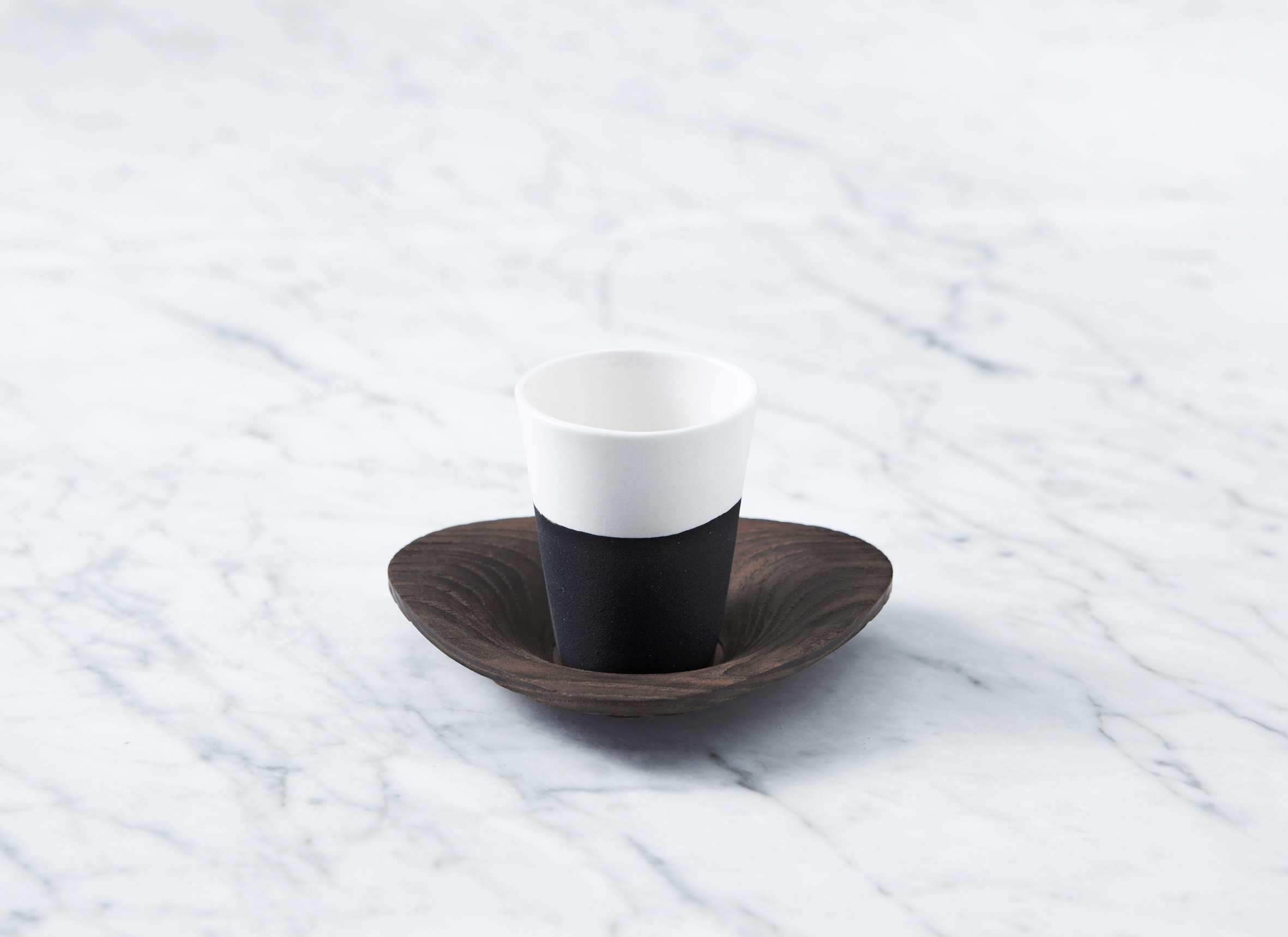 The St Ali porcelain cup and saucer set with turned ash saucer, designed by Fortynine Studio + TOH. Limted edition of 20 are available for $70 from the Campaign Store.  Go to www.theotherhemisphere.com for more.