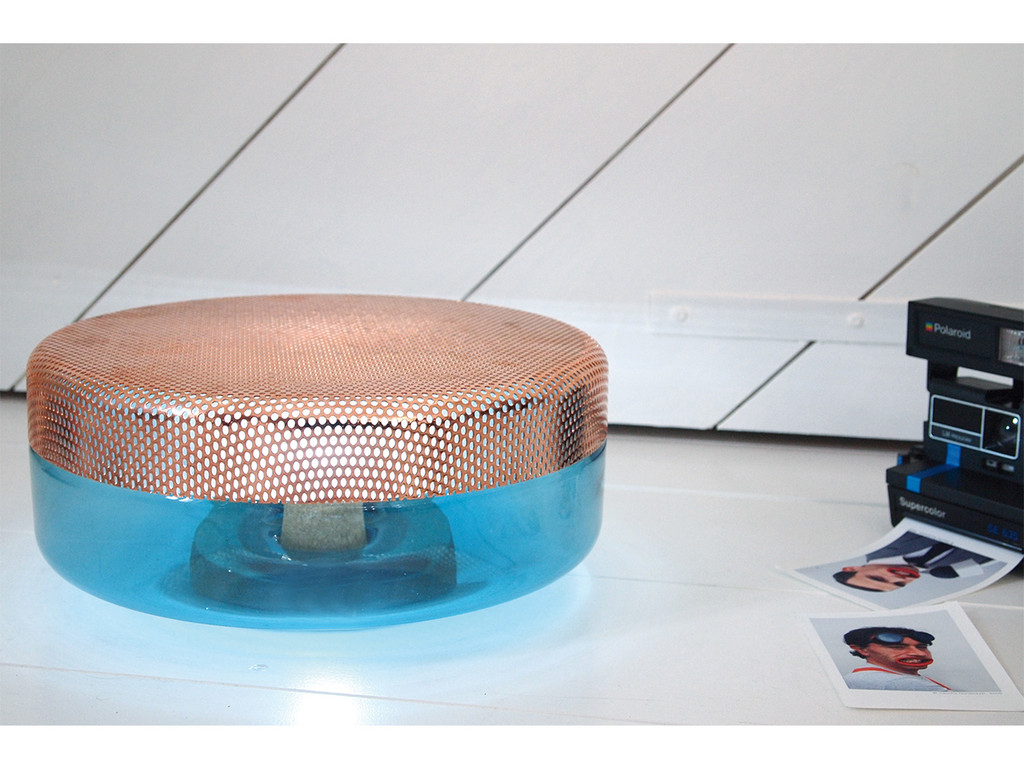 The e27 designed 'Light Drop' for Pulpo uses a covering of perforated metal over a glass base (released in 2013).