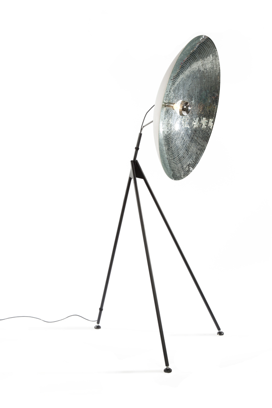 'Disco dish' is a floor light released by DHPH. It features hundreds of small pieces of mirror glued to the light's reflector.