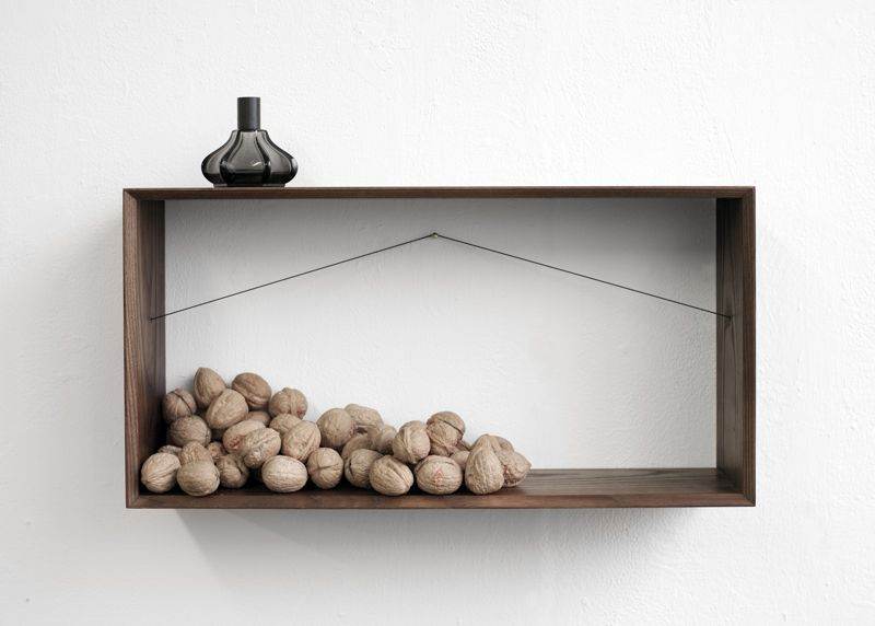 Bahbek Hashemi-Nezhad's 'Shelframe' hanging display system comes in two sizes and in portrait and landscape.