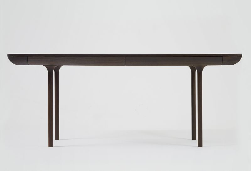 The 'Rúna' table by Isabel Ahm has a beautiful shape that incorporates four drawers (and two secret compartments).