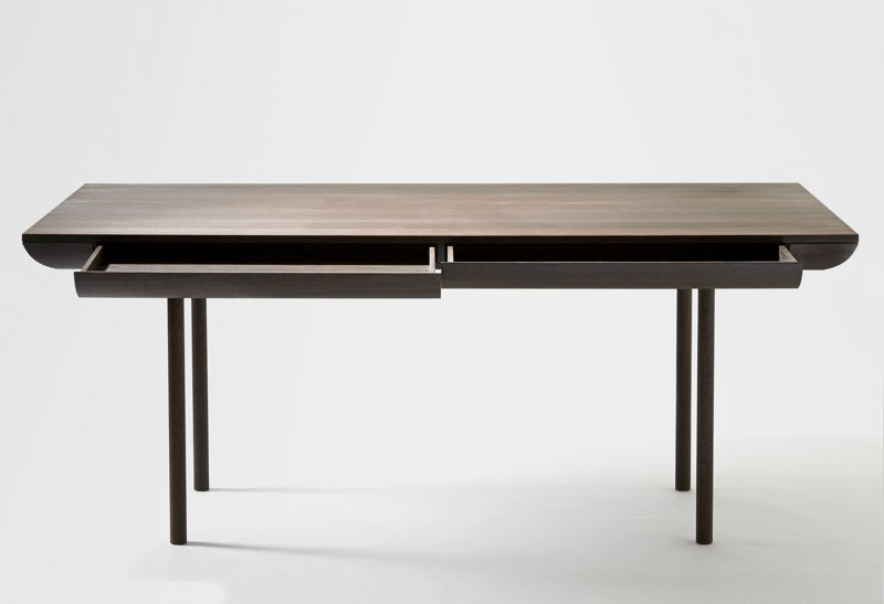 The 'Rúne' table's thin drawers are designed for a quick solution to table top clutter.