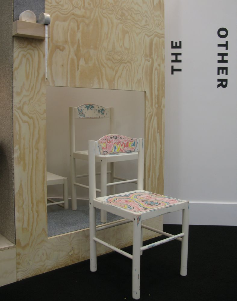 Elliat Rich's art piece 'Decennia' involved simple white chairs with 70 layers of lime paint. The idea is for the chairs to wear to reveal colours over time.