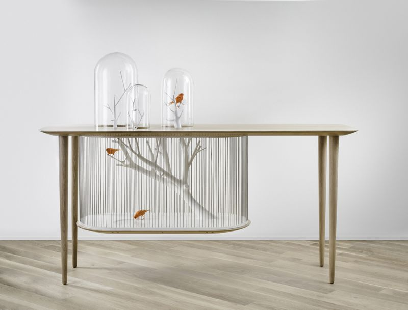 De Lafforest's desk and birdcage makes use of space above and below the table's surface.