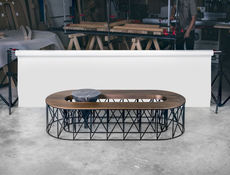 The seating version of 'EXO' combines an intricate metal framework with a cone of marble as an integrated side table.