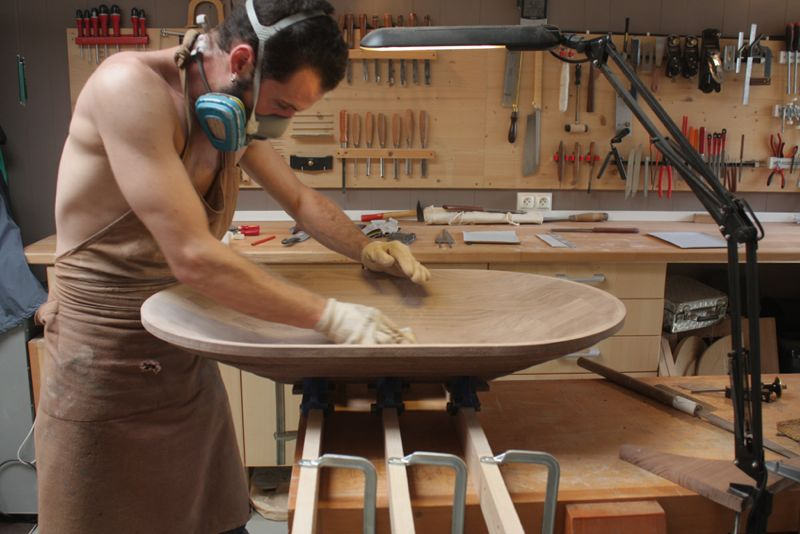 The outer shell of the 'Mono' mirror being hand-finished.