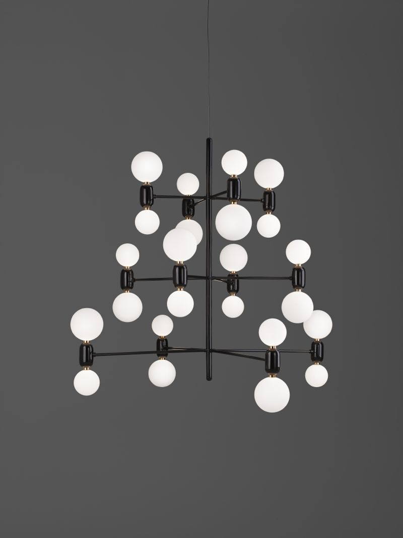 Hayon's 'Aballs' chandelier features 12 double ended fittings in ceramic and glass. Despite it's minimal structure, the light is full of surprise angles.