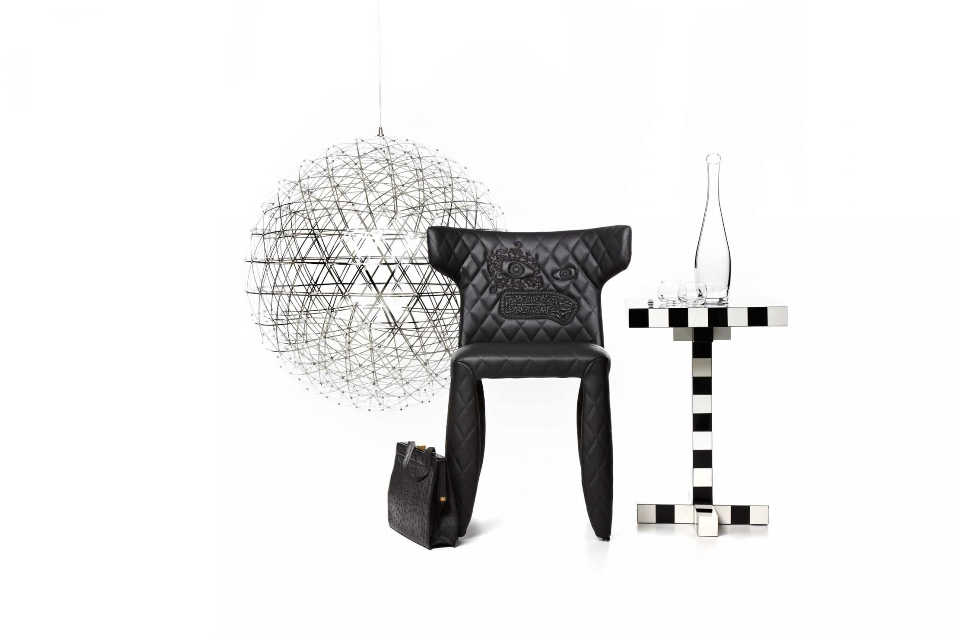 Some of Moooi's later products - The 'Raimond' LED pendant light (2007), the 'Monster' chair (2010) and the 'Chess' table (2009).