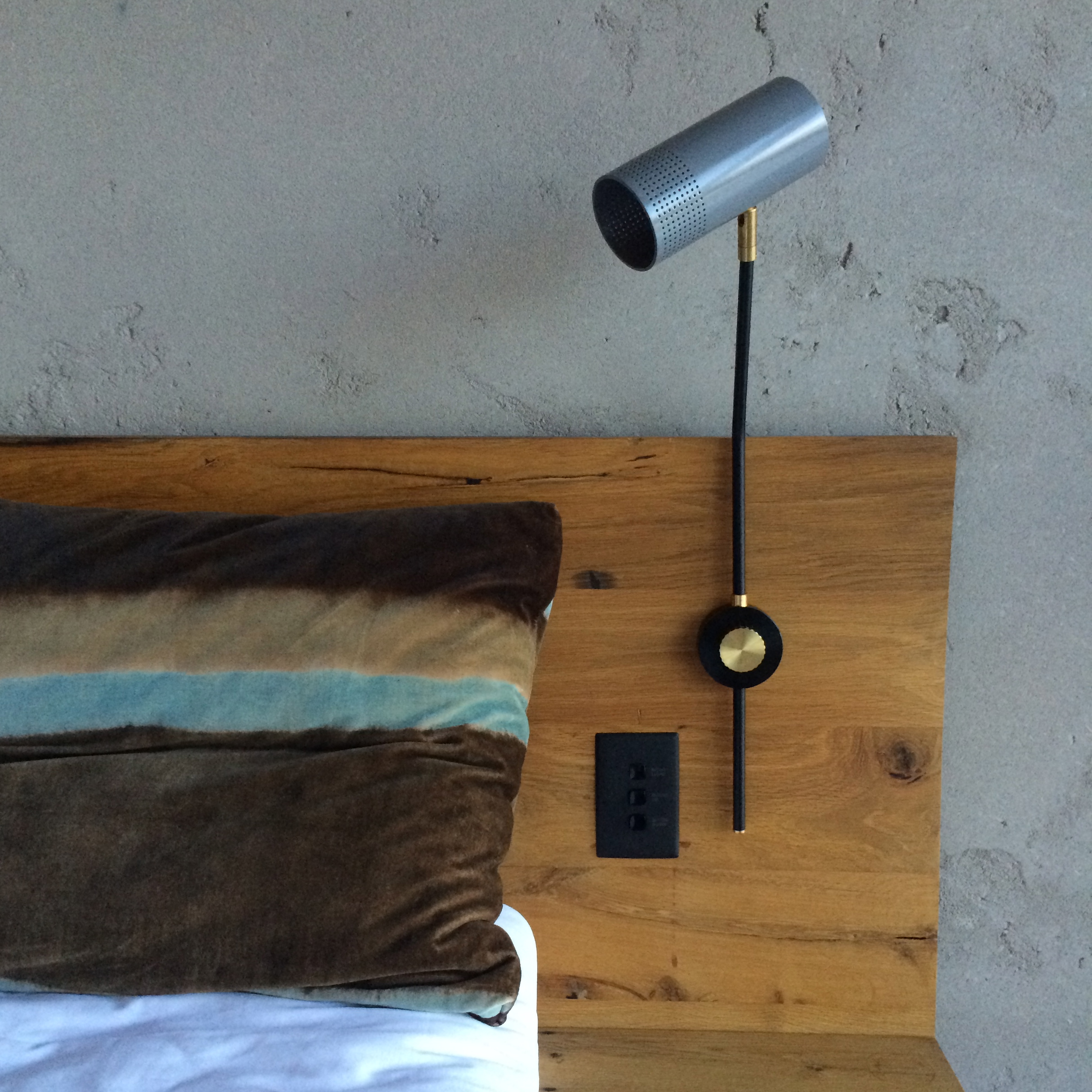 Vintage inspired lighting with brass detailing and aged oak are reoccurring themes in the hotel's rooms.