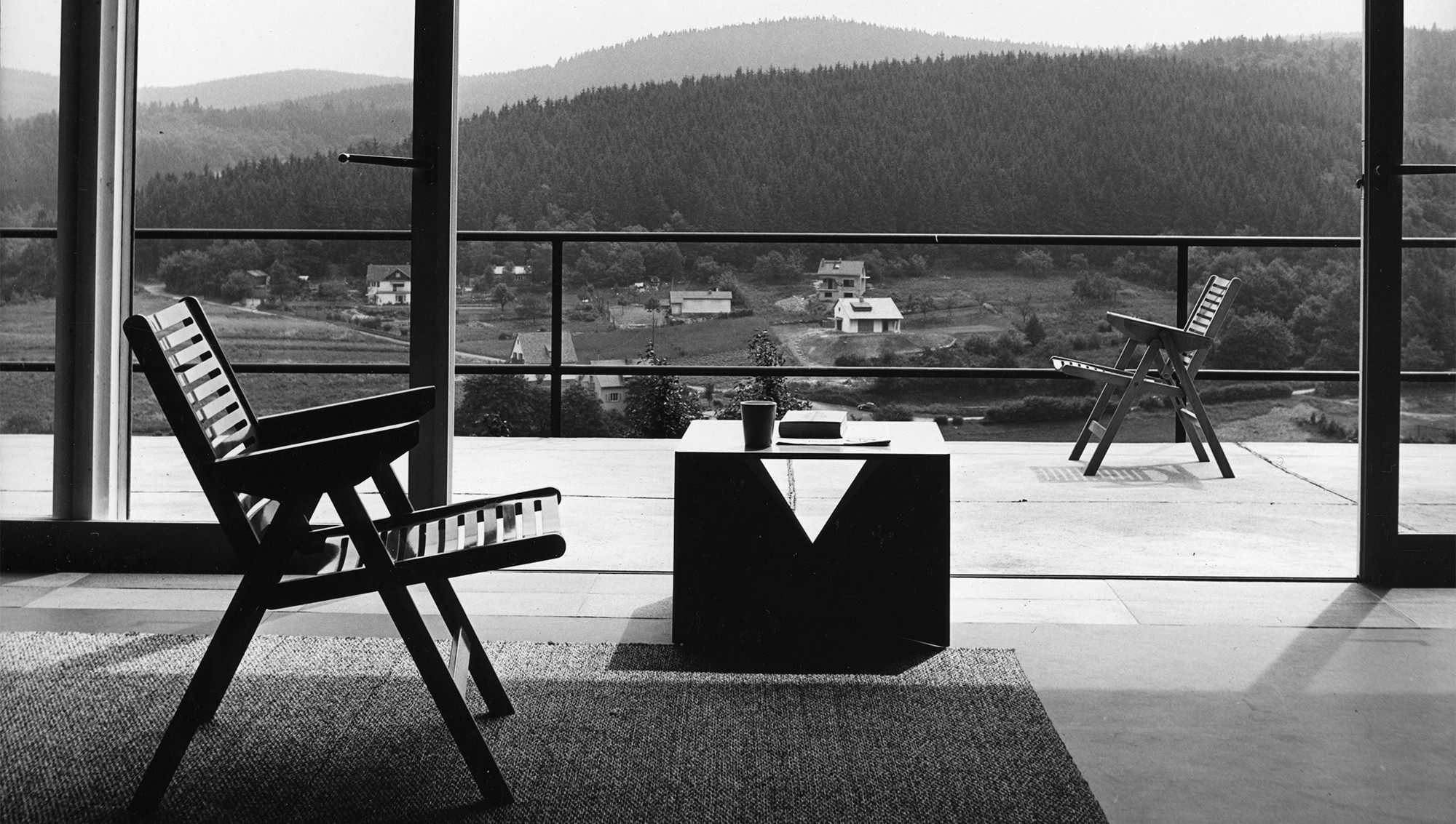 The 'Rex Lounge chair' was a folding design released in 1956 . The coffee table is by German architect, Ferdinand Kramer.