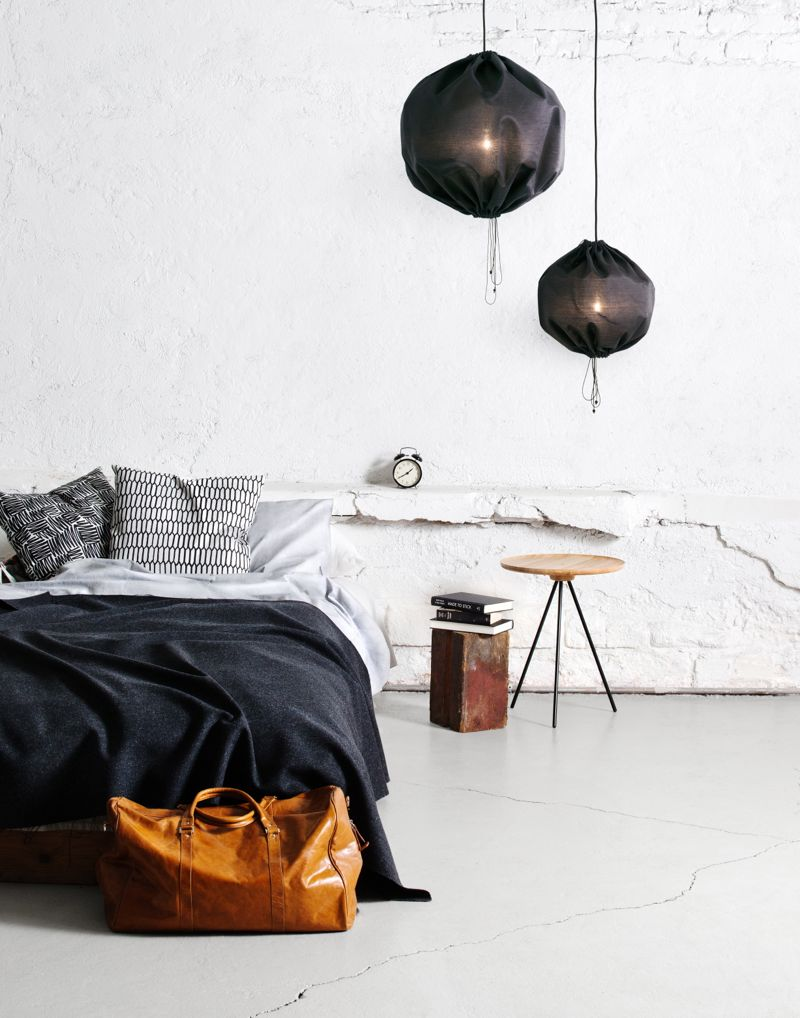 The type of relaxed and domestic feel that will move HEM from online store to lifestyle brand. The image features the 'Key' table by GamFratesi and 'Siksak' and 'Kenno' cushions by Sylvain Willenz. The 'Kuu' pendants are by Kerstin Sylwan and Jenny Stefansdotter. All of the above are One Nordic Furniture Company items.