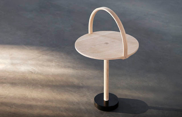 Thomas Sandell's 'February' side table with its beautiful hooped timber handle features a granite block at the base.