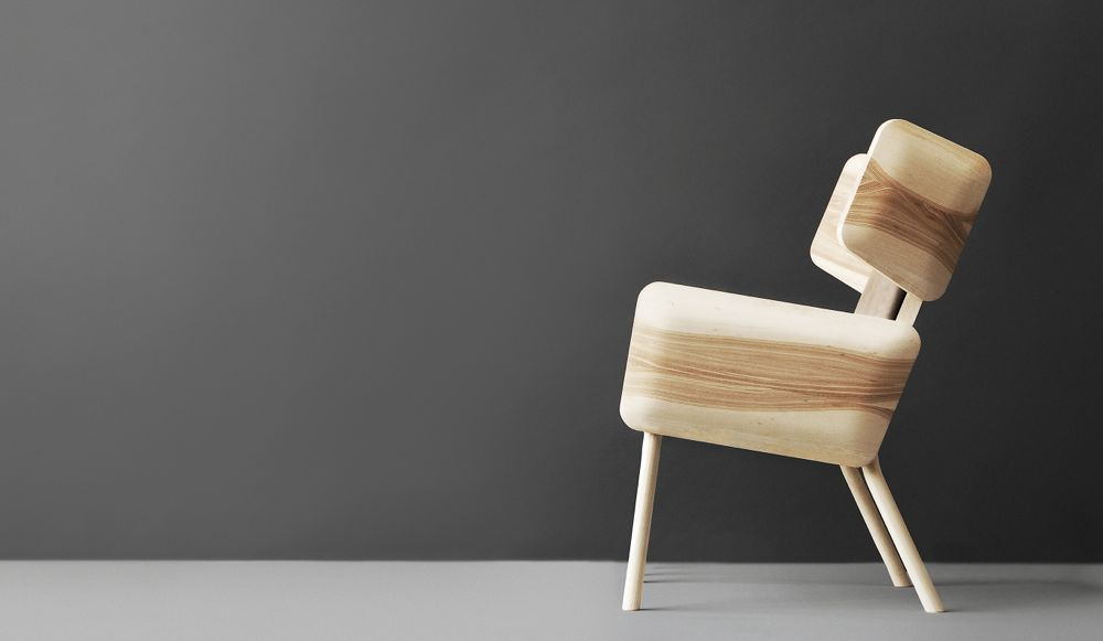 Wilhelmiina Kosonen's armchair in solid wood was chosen for the Aalto University study. It's rounded, exaggerated form has a cartoonish quality.