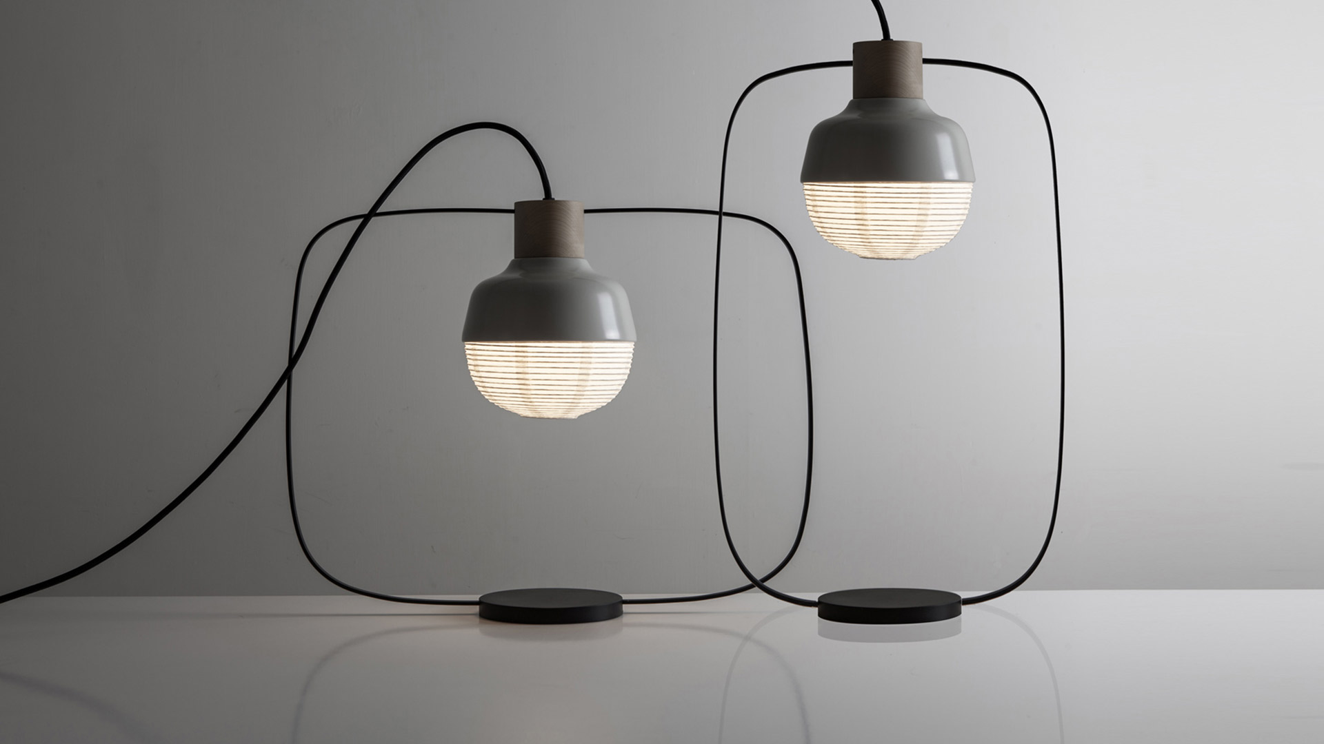 The 'New Old lights from Kimu Design combine fine metal frames and robust metal hoods that house a delicate paper shade.