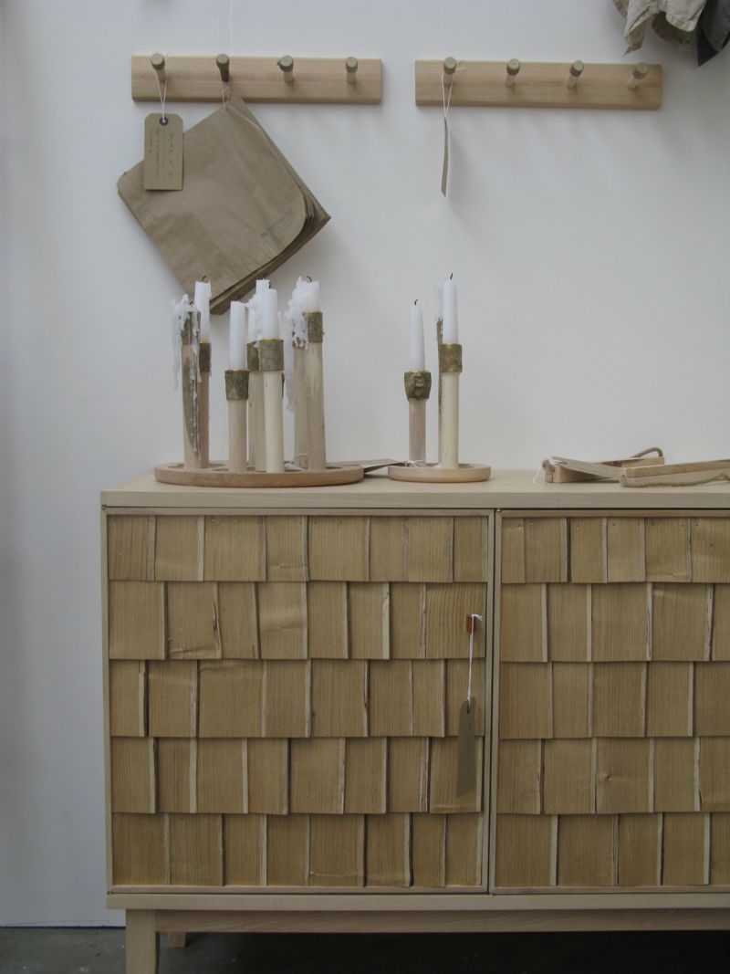 Sebastian Cox's stand at Tent London was a sea of rustic timber - with many designs retaining their bark as in the candle sticks above.