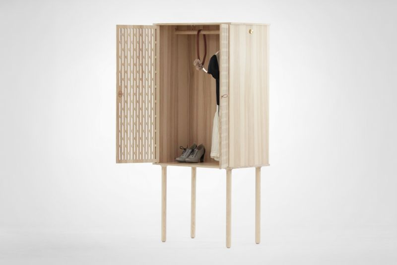 The 'Avignon' wardrobe from Codolagni features beautifully perforated doors and disproportionately long legs.