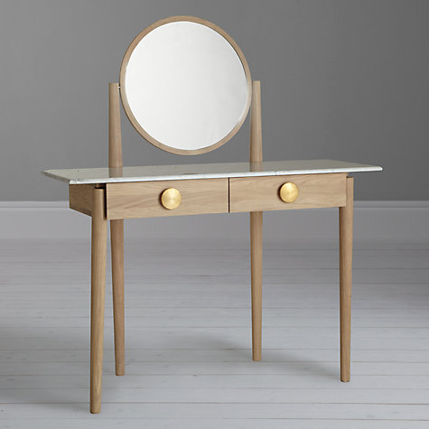 The 'Genevieve' dressing table by British designer Bethan Gray for John Lewis features brass handles, a marble top and pivoting mirror.
