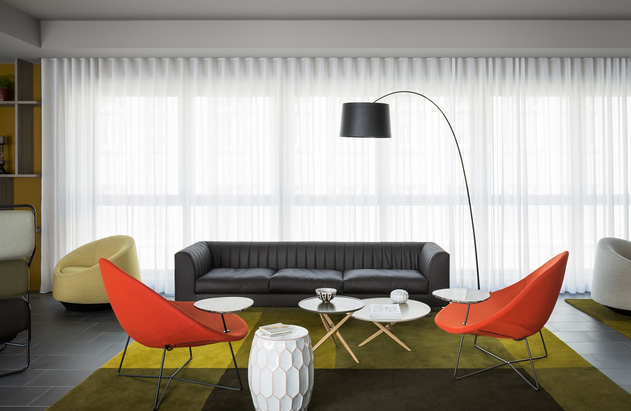 Although there are lots of Norguet designs throughout the interior - others like Marc Sadler's 'Twiggy' lamp feature too.