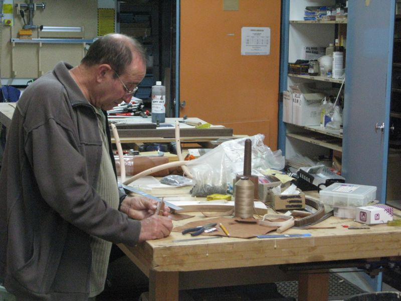 Amaro Mendes running some tests on scrap leather to show how the stitching would look on the finished chair.