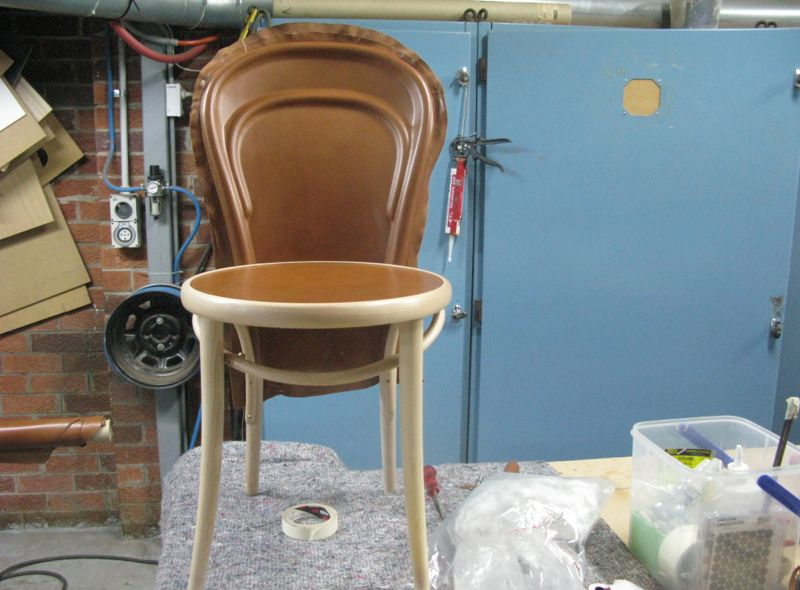 The partially completed chair before trimming the back and binding the front legs with thin strips of leather.