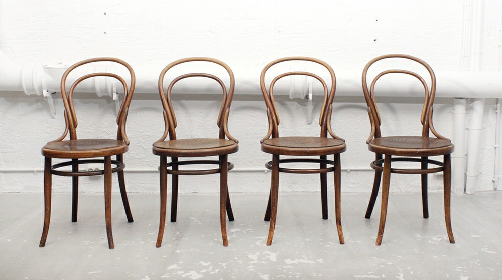 A row of orginal Thonet model 14 chairs first introduced in 1859. The raw chair provided for the TASFL project was a very similar chair from Czech manufacturer TON..