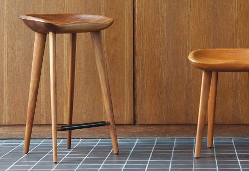 The original 'Tractor' stool by Bassam & Fellows is beautifully made in solid walnut and sold through Living Edge.