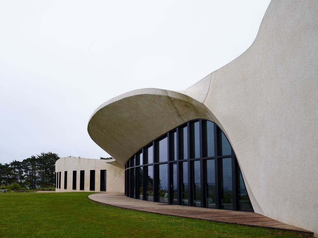 """Designed to age gracefully over time the rendered building has an organic flow to it that the architects like to refer to as like """"whale bones washed up and deposited by the sea""""."""