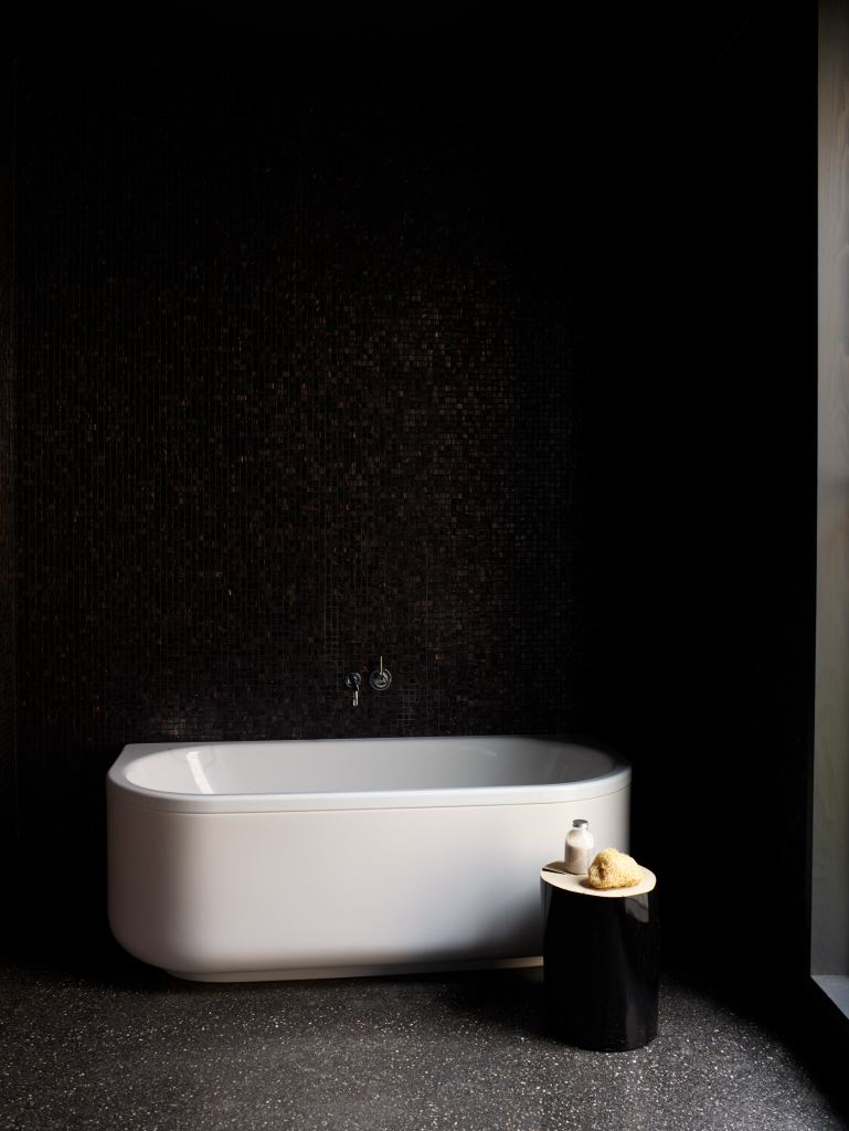 A number of the rooms are monochrome like this guest bathroom but there is someuse of rich colourtoo.
