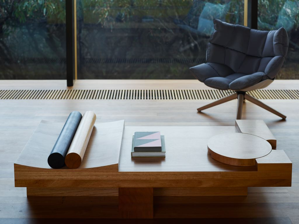 John Wardle's Fairhaven house is like a complex jigsaw of shapes. It's beautifully craftedtimber interior includes a number of furniture pieces by Wardle himself - like this coffee table. The cylinders to the left are to hold down papers, the disc on theright is a tray.