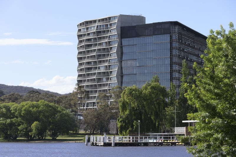 The southern face of Hotel Hotel and the Nishi building face onto Lake Burley Griffin, Photograph by