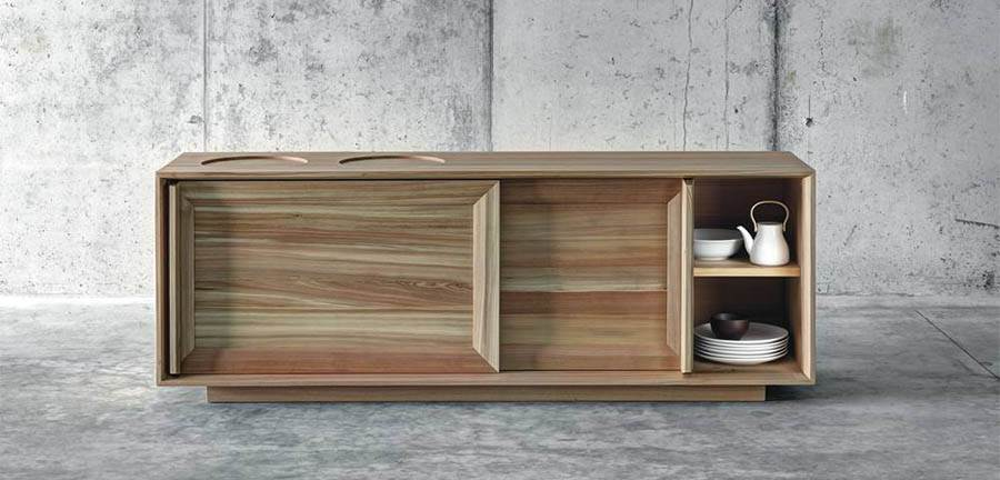 The 'Làres' sideboard by act_romegialli features recessed surfaces on the top and full length vertical  handles. The entire piece is in solid larch.