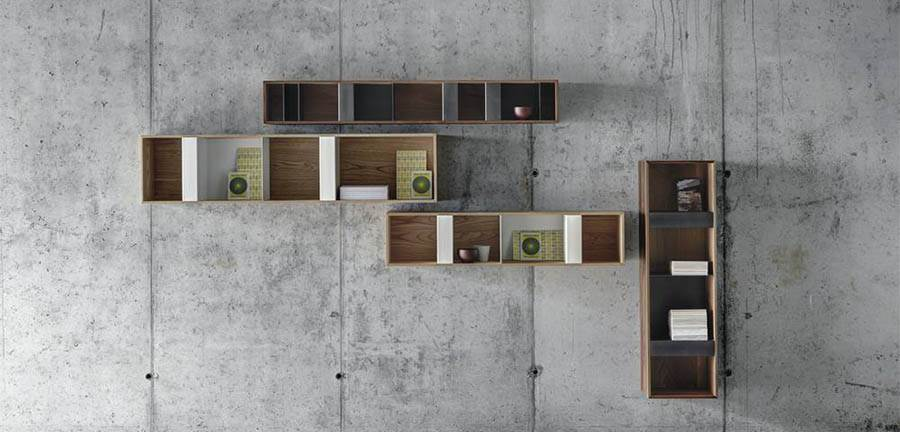 The 'T box' wall mounted storage units are made from chestnut or walnut and folded sheet steel.