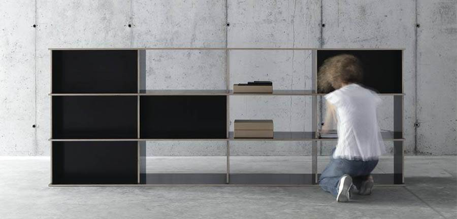 The CCRZ designed bookshelf 'J.M.B /4.3.2' is made from form ply with a black resin surface coating.
