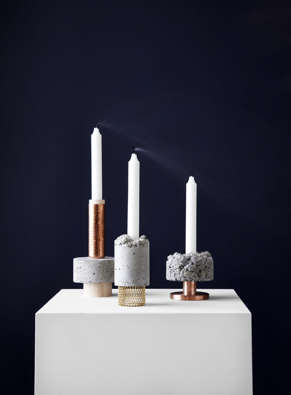 'Crowd' candleholders by David Taylor for New Works. Concrete, copper and brass in various material combinations and configurations.