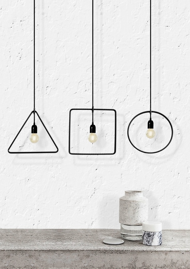 Three of the 'Geometry' lights styled beautifully with a few simple vessels.