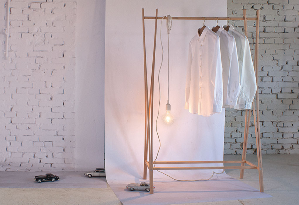 'Tra-ra' is an open wardrobe made from beech that packs away to a bundle of sticks when moving.