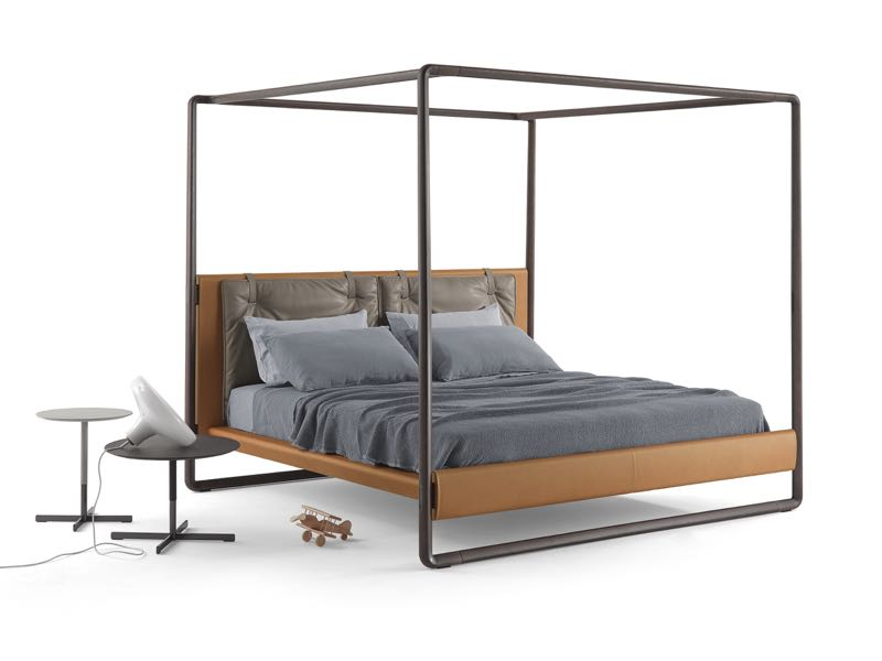The 'Volante' bed by Roberto Lazzeroni for Poltrona Frau. All chocolate stained oak and tan leather.