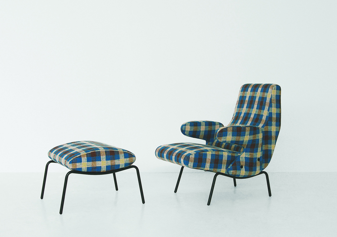 The 'Delfino' chair by Erberto Carboni is one of Arflex's many classics from the 50's but will be shown in this plaid fabric for a completely new look.