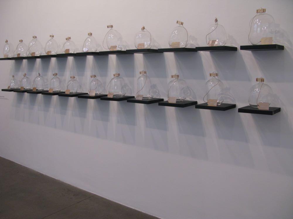 Formafantasma's wall of 'bottled breath' at the Daikon / Fabrica installation FUHA.