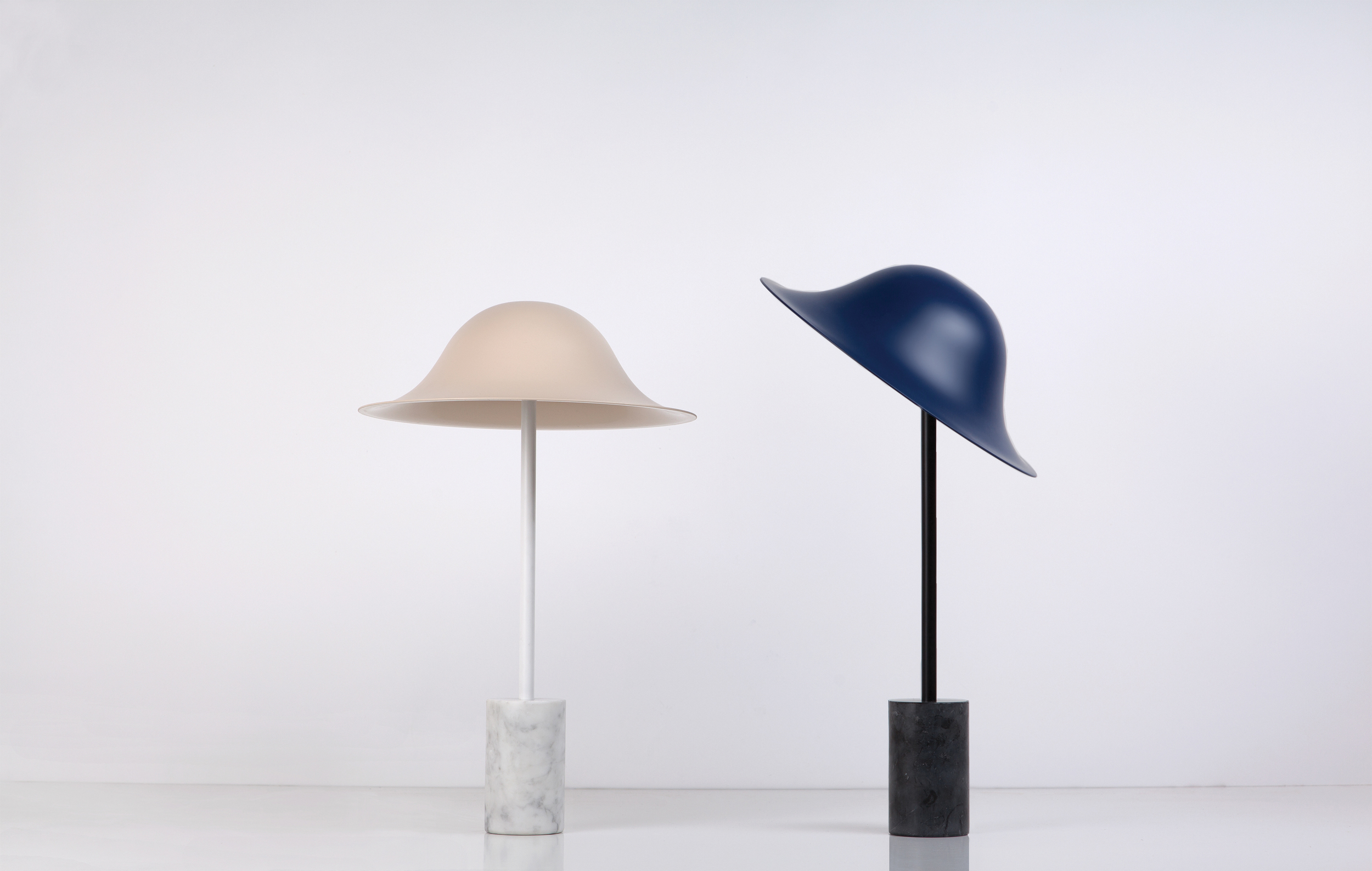 Joa Herrenknecht's 'Onda' bedside lamp has a marble base and metal 'helmet' that pivots on a ball magnet.