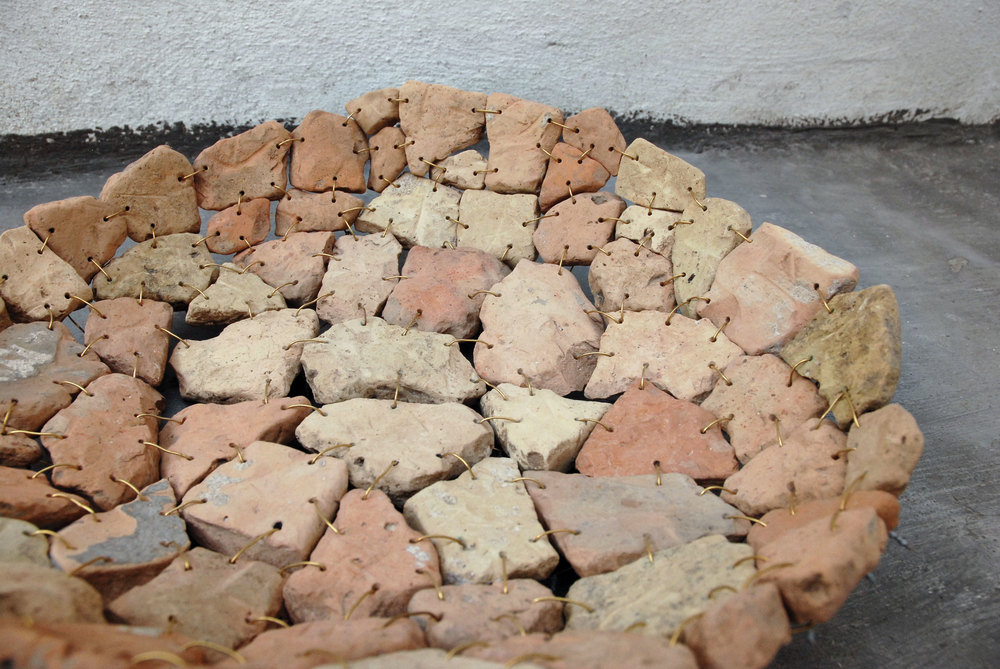 Frascina digs up terracotta shards from land around his home in Grottaglie and fashions them into bowls.