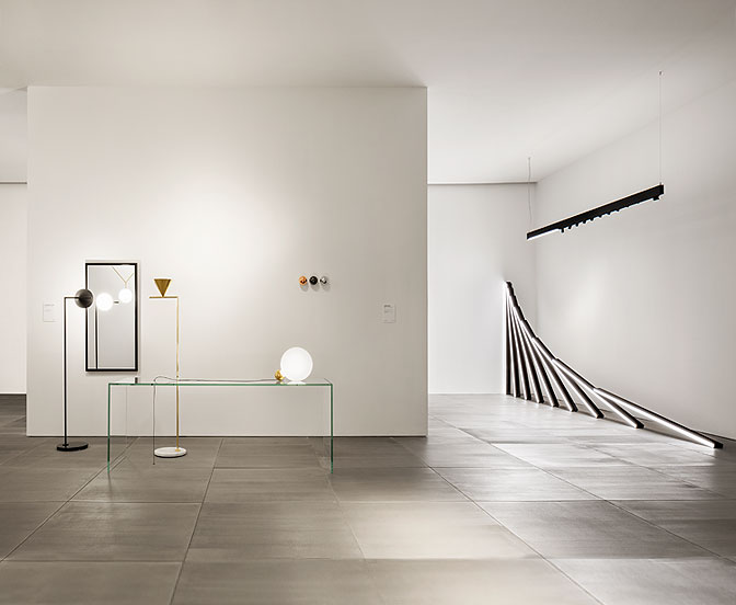 Part of the Gilad designed interior showing new lights, 'Captain Flint' and 'Copycat' by Michael Anastassiades. The light on the right is called 'Running Magnet' by Flos Architectural.