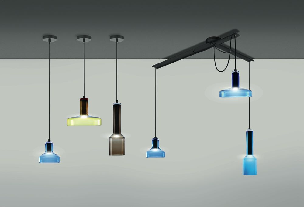 'Stab' lights by Arik Levy for Danese.  Three shapes of glass in several colours can be hung individually or grouped via an articulating mechanism.