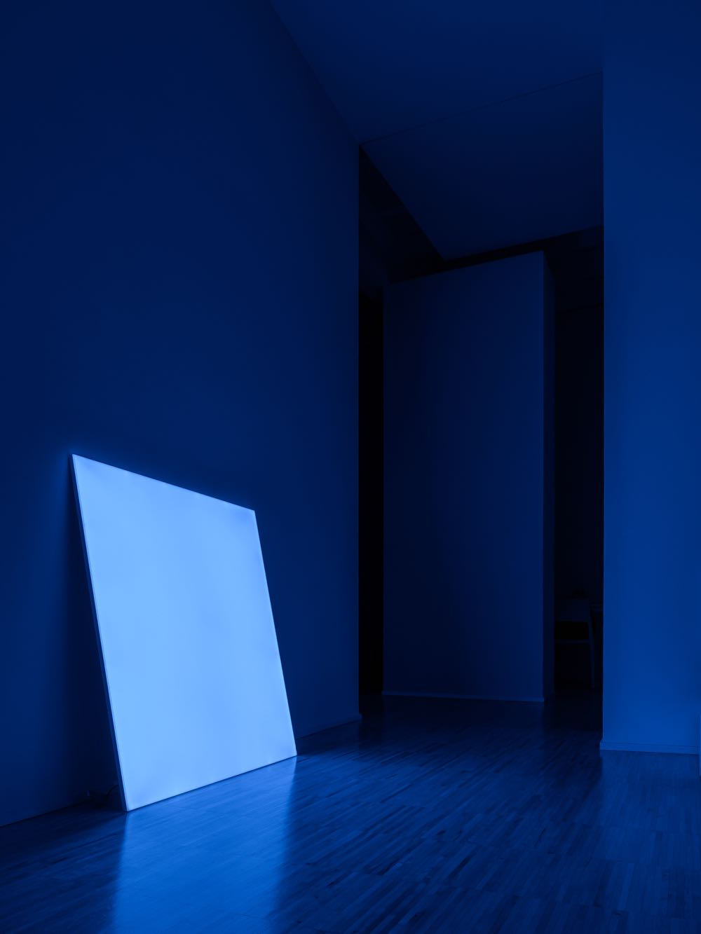 'Pablo' by Davide Groppi for Davide Groppi. Reminiscent of an artwork leaning against a wall, the design has a RGB controller to alter the colour of the light.