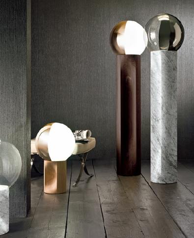 The 'Jesuis' table and floor lights by Carlo Colombo for Penta. Timber or marble plinths with glass orbs.