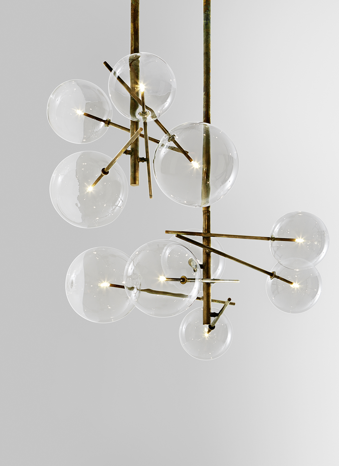The 'Bolle' light in copper brass and glass by Gallotti & Radice.