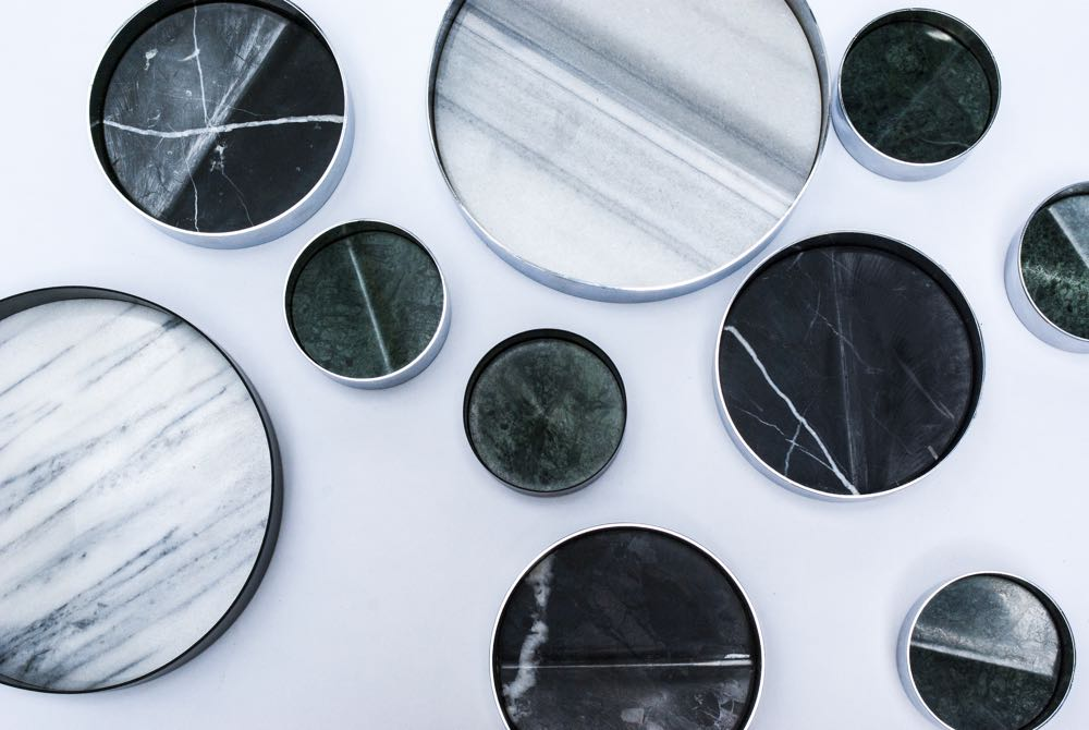 The 'Pli' bowls by Beaverhausen for La Chance. Three sizes in polished metal with three different marbles.