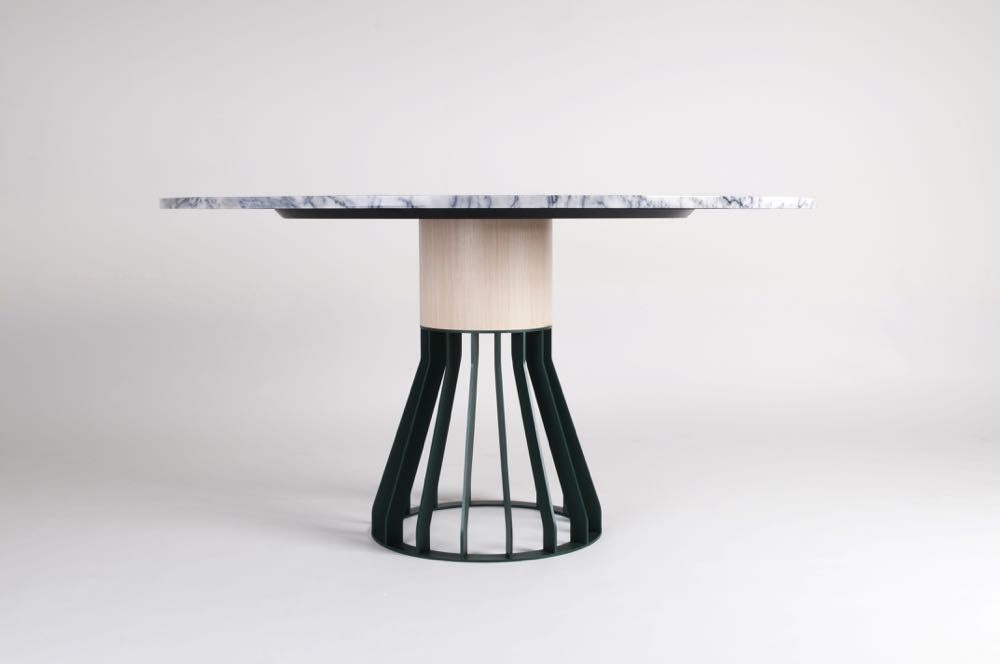The 'Mewoma' table by American designerJonah Takagi. The name comes from MEtal , WOod & MArble.